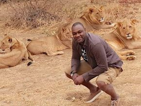 Yes, this picture of Patrick Mboma in front of lions is authentic